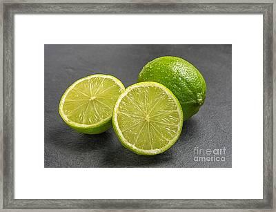 Limes On A Slate Plate Framed Print by Palatia Photo