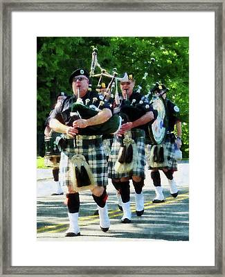 Line Of Bagpipers Framed Print by Susan Savad