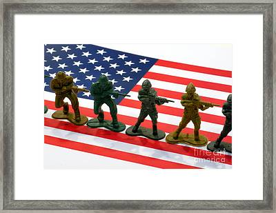 Line Of Toy Soldiers On American Flag Crisp Depth Of Field Framed Print by Amy Cicconi