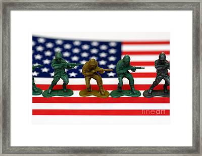 Line Of Toy Soldiers On American Flag Shallow Depth Of Field Framed Print by Amy Cicconi
