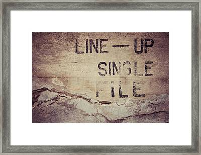 Line Up Single File Framed Print