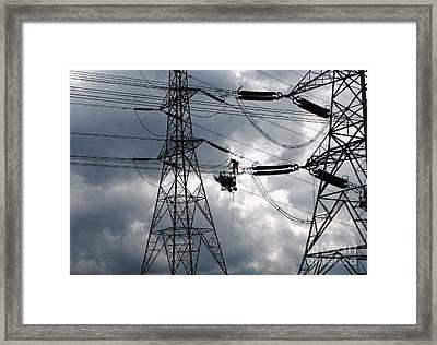 Lineman Framed Print by John Chatterley