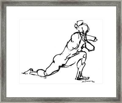 Lining Up Framed Print by Karl Gnass