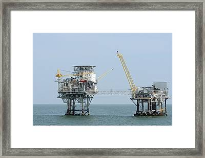 Framed Print featuring the photograph Linked Well Platforms by Bradford Martin