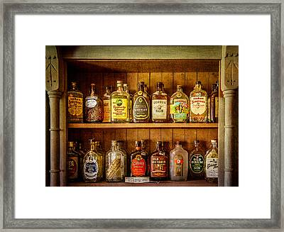 Liquor Cabinet Framed Print by Paul Freidlund