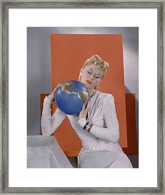 Lisa Fonssagrives Holding A Globe Framed Print