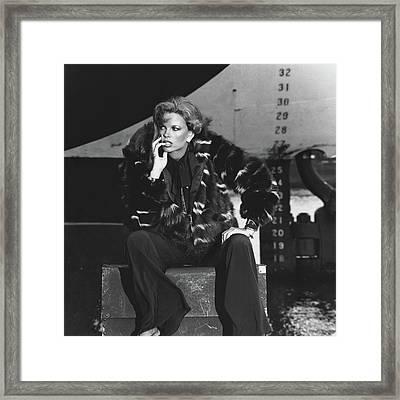 Lisa Taylor Wearing A Skunk Jacket Framed Print by Guy Le Baube