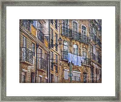 Lisbon Street Face Framed Print by Hanny Heim