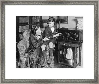 Listening To Radio Show Framed Print by Underwood Archives