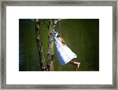 Litte Girl Swinging In White Dress Framed Print by Donna Doherty