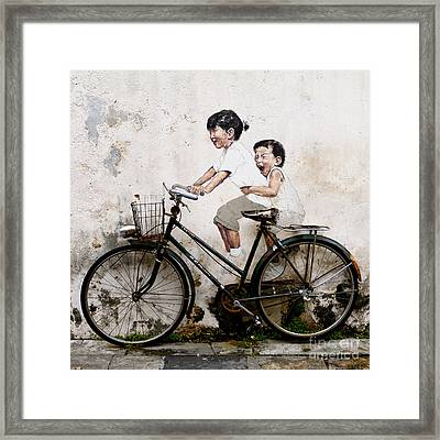 Little Children On A Bicycle Framed Print by Donald Chen