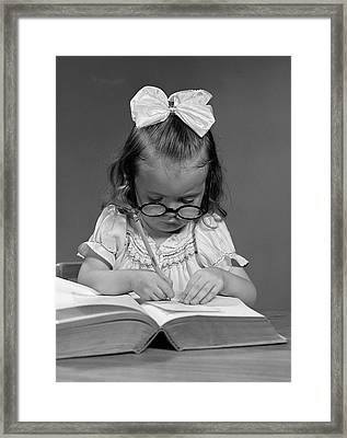 Little Girl, Big Book, C.1940s Framed Print by H. Armstrong Roberts/ClassicStock