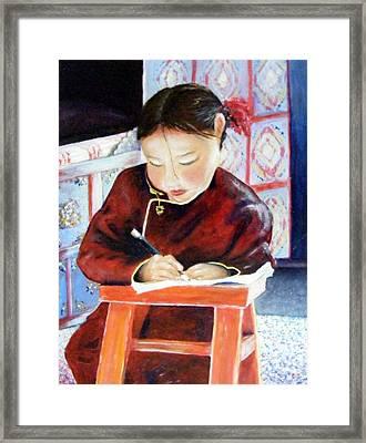 Little Girl From Mongolia Doing Her Homework Framed Print