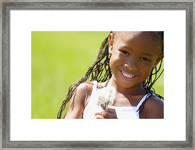 Little Girl Holding Weeds Framed Print by Hanson Ng