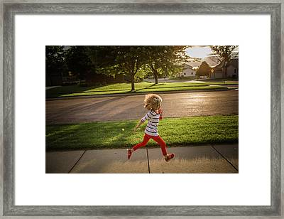 Little Girl Running Framed Print by Annie Otzen