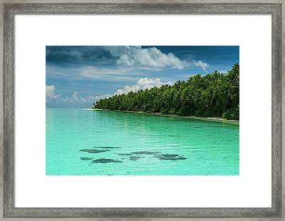 Little Islet And Turquoise Water Framed Print by Michael Runkel
