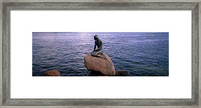 Little Mermaid Statue On Waterfront Framed Print by Panoramic Images