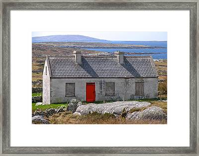 Little Red Door II Framed Print by Suzanne Oesterling