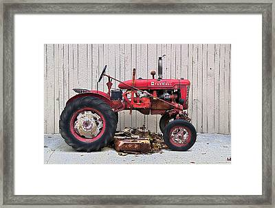 Framed Print featuring the photograph Little Red Farmall by Craig T Burgwardt