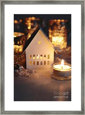 Framed Print featuring the photograph Little White House Lit With Candle For The Holidays by Sandra Cunningham