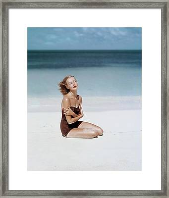Liz Benn Sitting On A Beach Framed Print by John Rawlings