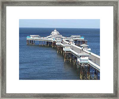 Framed Print featuring the photograph Llandudno Pier by Christopher Rowlands