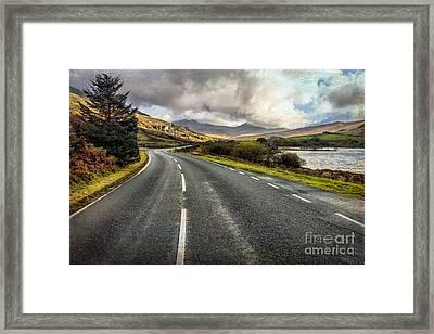 Llynnau Mymbyr Pass Framed Print by Adrian Evans