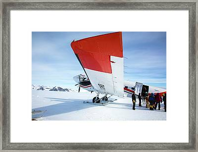 Loading An Aircraft In Antarctica Framed Print by Peter J. Raymond