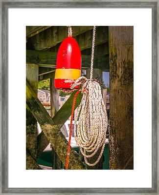 Lobster Buoy Under Pier Framed Print by Ernest Puglisi