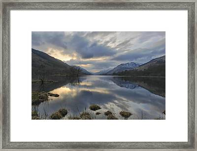 Loch Voile As Sundown Approaches Framed Print by Buster Brown