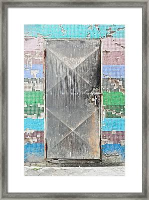Locked Door Framed Print by Tom Gowanlock