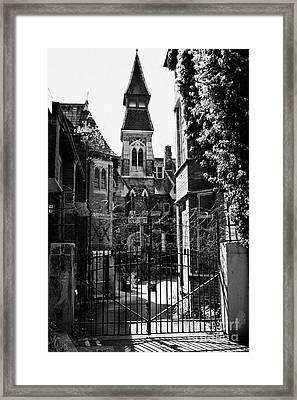 locked gates at old st josephs orphanage building Preston Lancashire UK Framed Print by Joe Fox