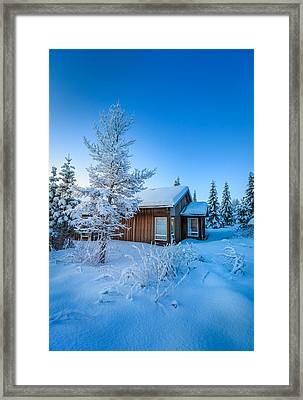 Log Cabin And Snow Covered Trees Framed Print