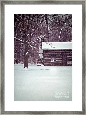 Log Cabin In Snow Framed Print