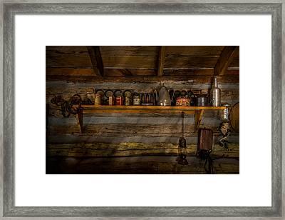 Log Cabin Shelf Framed Print by Paul Freidlund