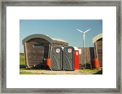 Log Cabins And A Wind Turbine Framed Print by Ashley Cooper