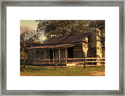 Log Cabins In Sunset Framed Print by Linda Phelps