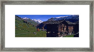 Log Cabins On A Landscape, Matterhorn Framed Print by Panoramic Images
