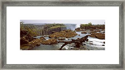 Log On The Rocks At The Top Framed Print