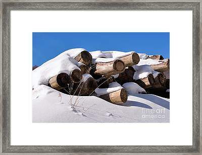 Log Pile In A Snow Drift In Winter Framed Print by Louise Heusinkveld