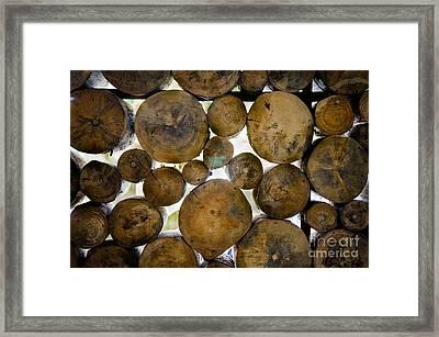 Log Stack Framed Print by Receb Parsel