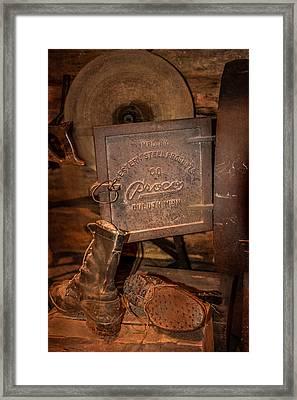 Logging Boots Framed Print by Paul Freidlund