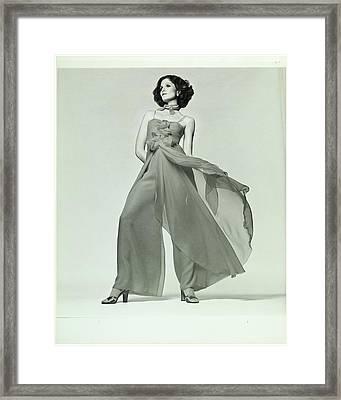 Lois Chiles Wearing A Silk Chiffon Pajama Framed Print by Francesco Scavullo