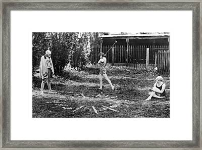 London Bathers Play Clock Golf Framed Print by Underwood Archives