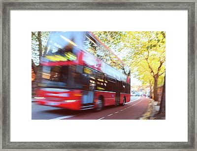 London Red Double Decker Bus Driving At Framed Print by Pavliha