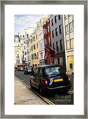 London Taxi On Shopping Street Framed Print by Elena Elisseeva