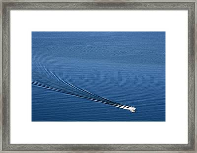 Lone Boat Framed Print by Laurie Poetschke