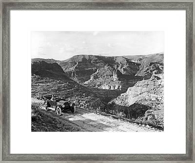 Lone Car In Fish Creek Canyon Framed Print