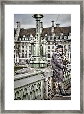 Lone Piper Framed Print