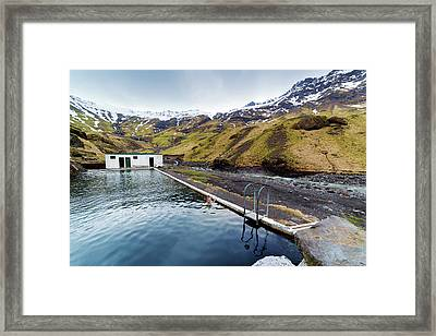 Lone Tourist At Seljavallalaug Pool Framed Print by Anna Gorin